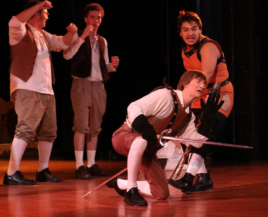 Alexi Lewis (12) attacks Matthew Shute (12) during a fight scene in Don Quixote.