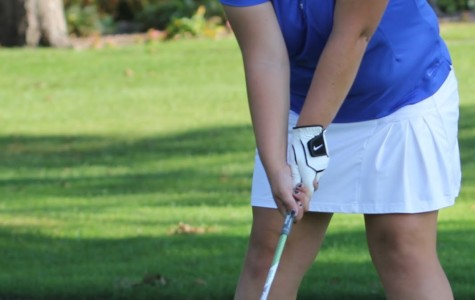 Amanda Blais (11) sets up her shot at the girls golf match against Crown Point.