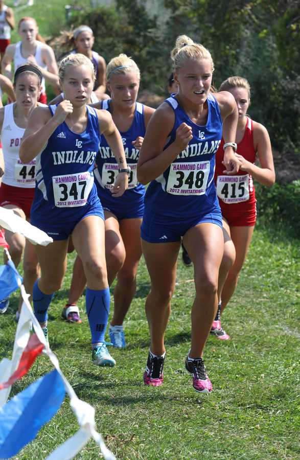 Alaina Willis (12) runs up the hill at the Gavit Invitational held at Dowling Park.  Joule Tazbir (9) and Hallee Willis (12) followed closely behind to form a pack of Indians in the race.
