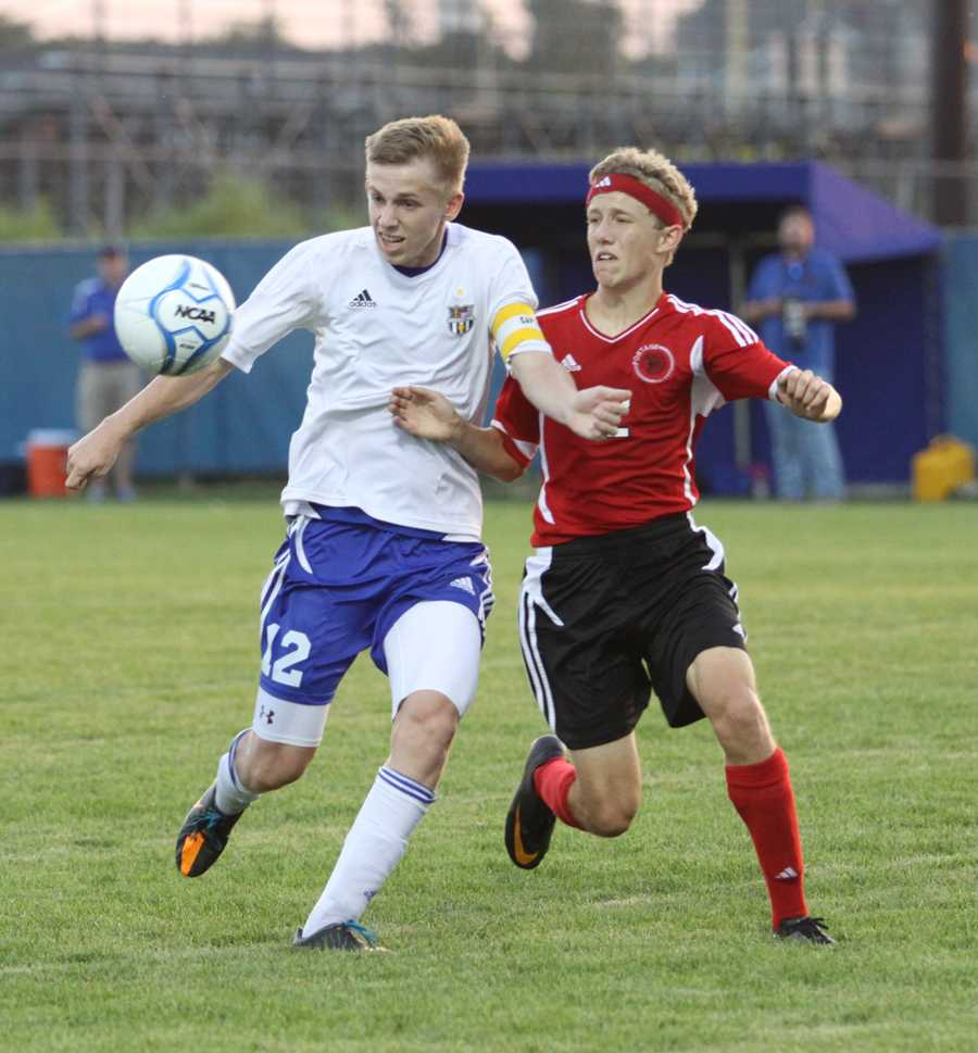 Joshua Crague (12) blocks a Portage opponent from attacking the ball. Throughout the game, Crague made several attempted shots for a goal.