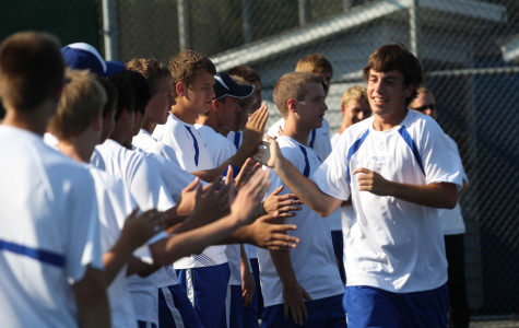 Alec Pickert (12) runs down the line of his teammates as his name was called for the starting lineup.