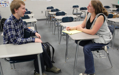 Mrs. Clark, English,  reviews her notes taken during the Best Buddies interviews.  Students interested in Best Buddies are interviewed to be paired with a West Lake student.
