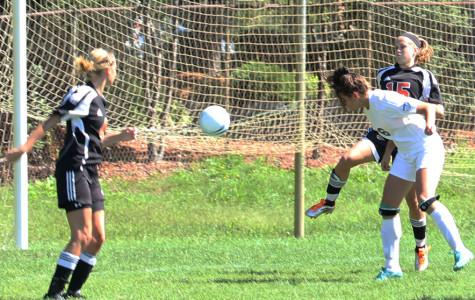 Lauren Doreski (12) heads the ball into the LaPorte net. The Indians won 5-0 over LaPorte with 3 goals from Doreski.