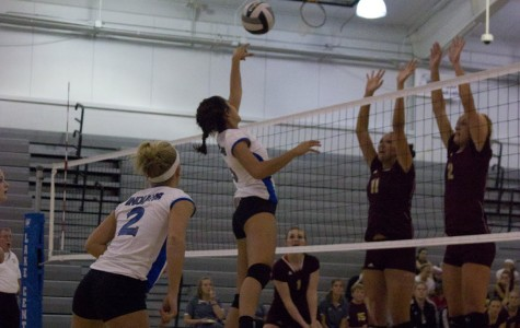 Kimberly Kayes (12) smacks the ball over the net.  The girls played hard and well during the game.