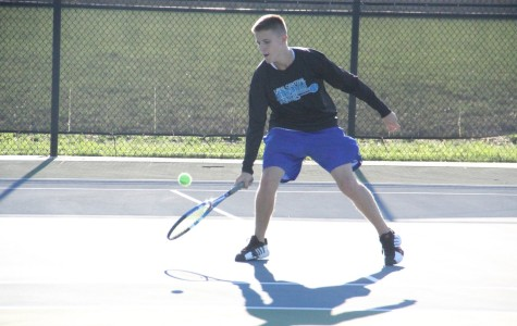 Todd Banvich (12) goes for a backhand shot in Lafayette on Saturday. Banvich lost in the 3 singles championship.
