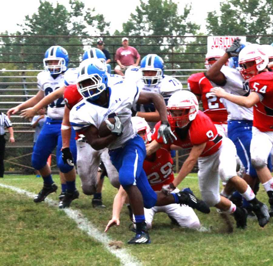 Charles Sykes (10) breaks away from Portage defenders.  Sykes sprinted downfield to score for the Indians.