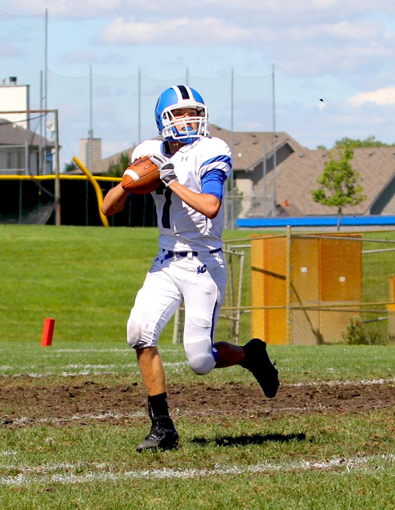 Freshman on JV football, Colin Studer goes in for a big pass. He looked for his team mates to catch the pass to score against Crown Point.