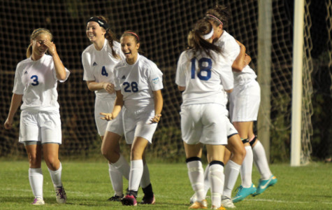 Varsity players celebrate their win against Chesterton.  The girls tackled Lauren Doreski (12) after she kicked in the final goal.