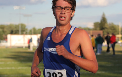 Chris Albright (12) finishes the grueling meet on Tuesday, Sept.  18. Albright ran his heart out despite the cold weather.