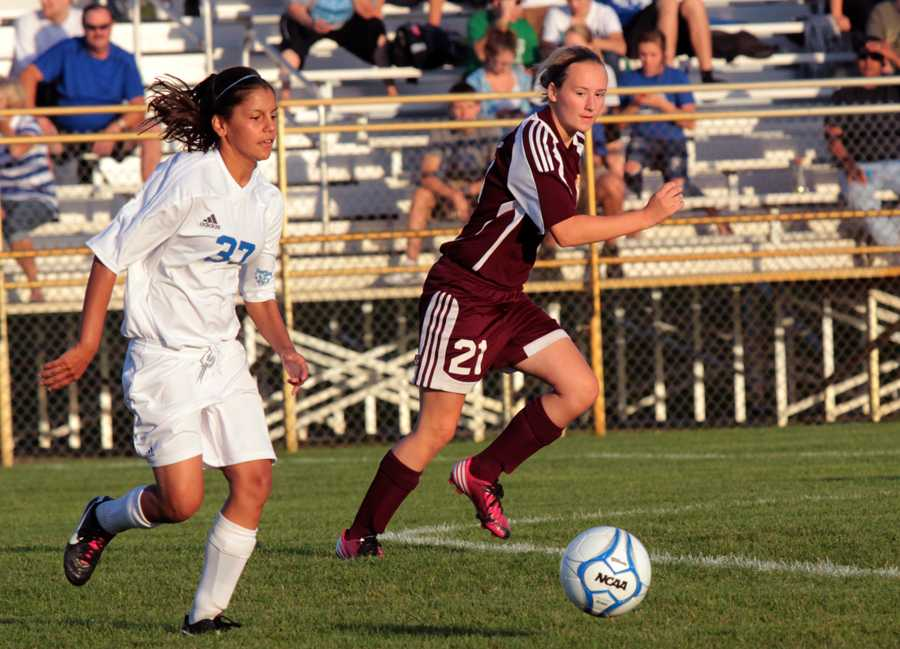 Lakshmi Lewis (9) runs down the field with the ball, a Chesterton competitor close by. The LC girls worked hard to defeat the Trojans 2-1.