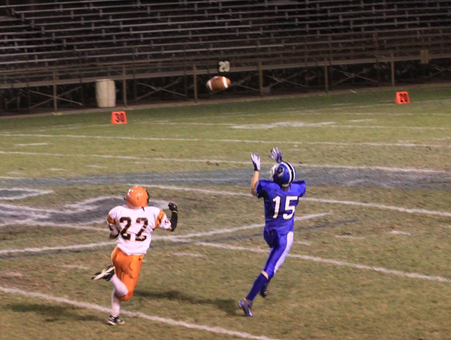 Just seconds from the game ending, Zachary Turnbough (9) catches the ball. Anxiously running, to make a winning touchdown. LC took over Laporte with a 26-21, last Thursday.
