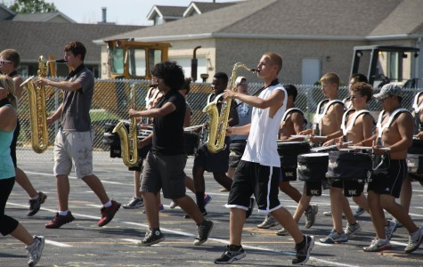 Andres Ramirez (10) plays the saxophone during a Tuesday afternoon practice. Marching band kids practiced three hours a day besides Tuesdays.