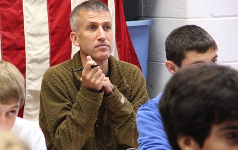 Wall Street Journal reporter Michael Philips sits in on Mr. Tom Clark's history class in August.
