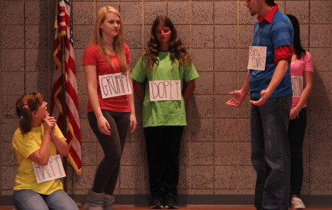 """Mia Djeldum (12), Kearney Fagan (12), and Alex Tinklenberg (12) act out a scene at the improv show. Their group dressed up as """"Snow Tinks and the Seven Dwarfs"""" to highlight the night's Halloween theme."""