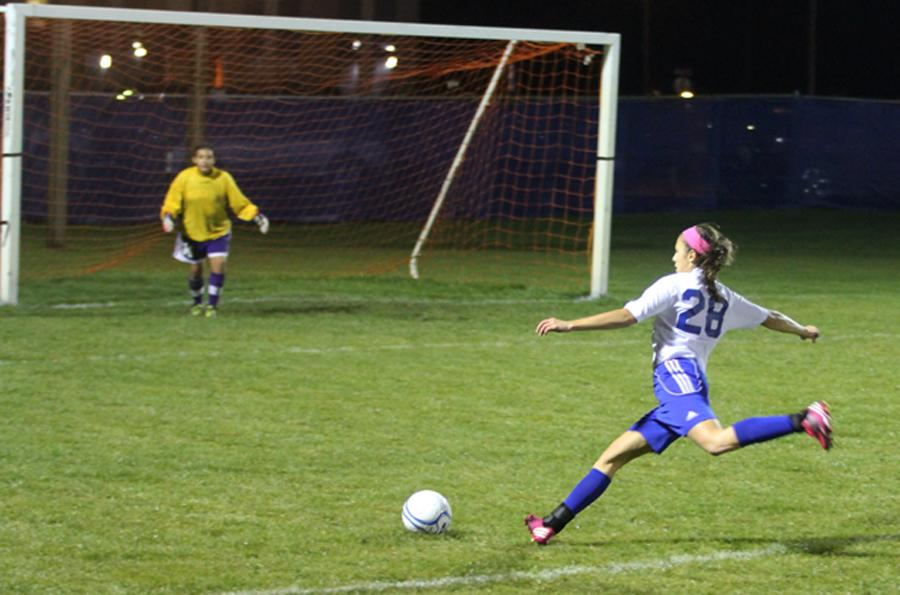 At the varsity girls soccer away game on Oct 4, Brianna Dougherty (10) prepares to kick the ball into the goal. The Gavit goalie dove to prevent the LC girls from scoring a goal.