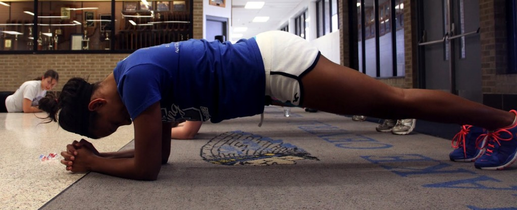 Holly Spears (11) holds a plank pose during the girls' workout. All the girls did an entire ab circuit on Wednesday.