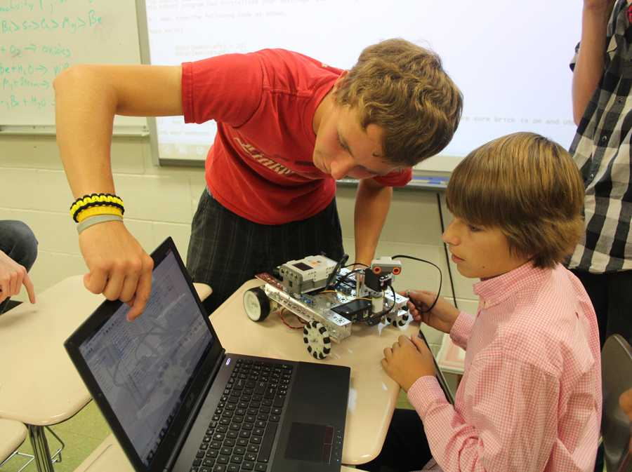 Chase+Owczarzak+%2810%29++watches+as+Daniel+Shanks+%2812%29+explains+a+control+on+the+robot.+Robotics+club+started+preparing+for+their+competition+in+March.+