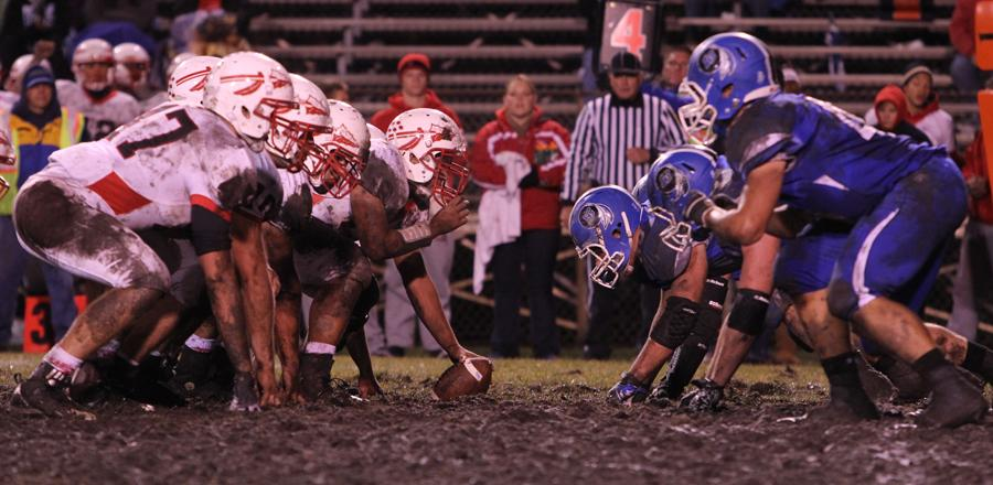 LC Indians play on the incredibly muddy field under the Friday night lights. Despite the terrible conditions, the Indians pulled off a win.