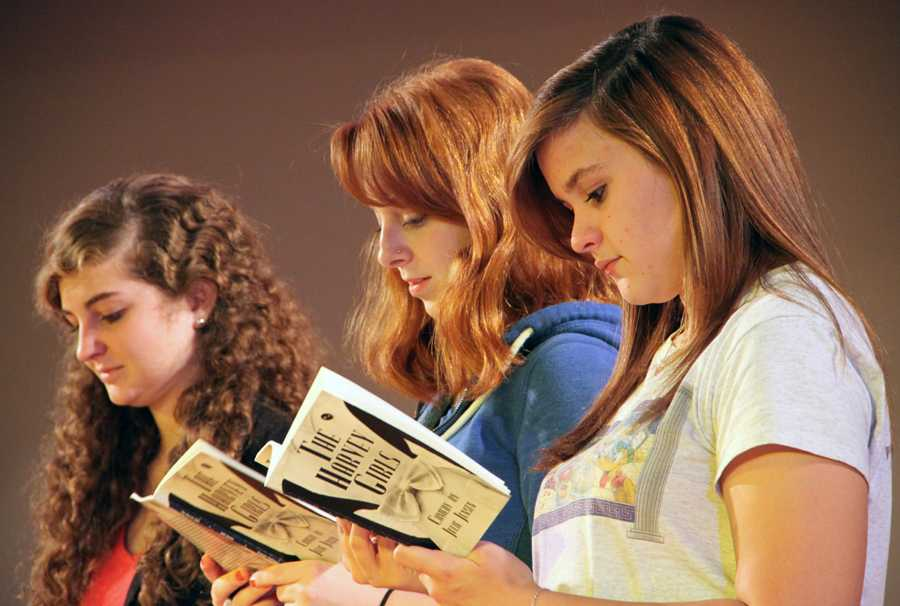 Alyssa Graziani (11) Caroline Janiga (11) and Lauren Basting (11) review their scripts during a Thursday night practice.  The show premieres November 2.