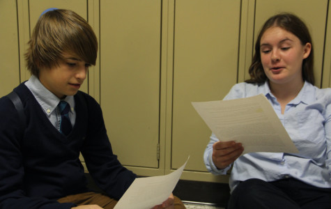 Chase Owczarzak (10) and Noel ? (?) discuss new rebuttals for the next round of Lincoln-Douglas debate. This debate competition at Valparaiso was the first one the team participated in this year.