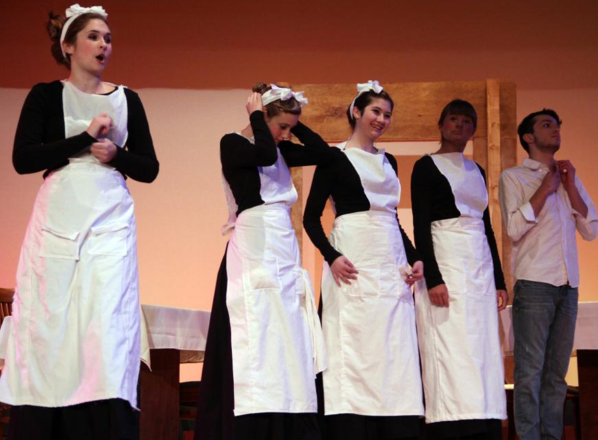 Alayna Wallace (10) commands Rachel Yorek (9), Brianna Mamelson (11), Megan Barry (9), and Jonathan VanHecke (11) in the Harvey Girls as they learn how to be better workers.  The Harvey Girls performed for two weekends.