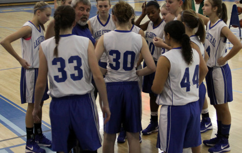 Coach Scott Freckelton, Mathematics, gives a pep talk to the Freshman Girls basketball team during the game Monday. The girls defeated Valparaiso 36-26.
