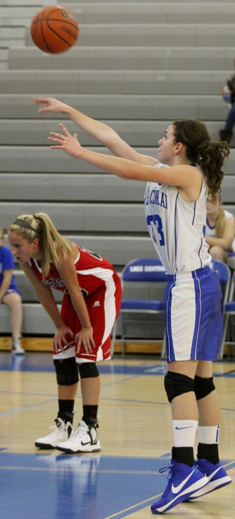 Renee DiNino (9) shoots a free throw after being fouled by a Portage player. DiNino made the basket and earned Lake Central one point for the shot.