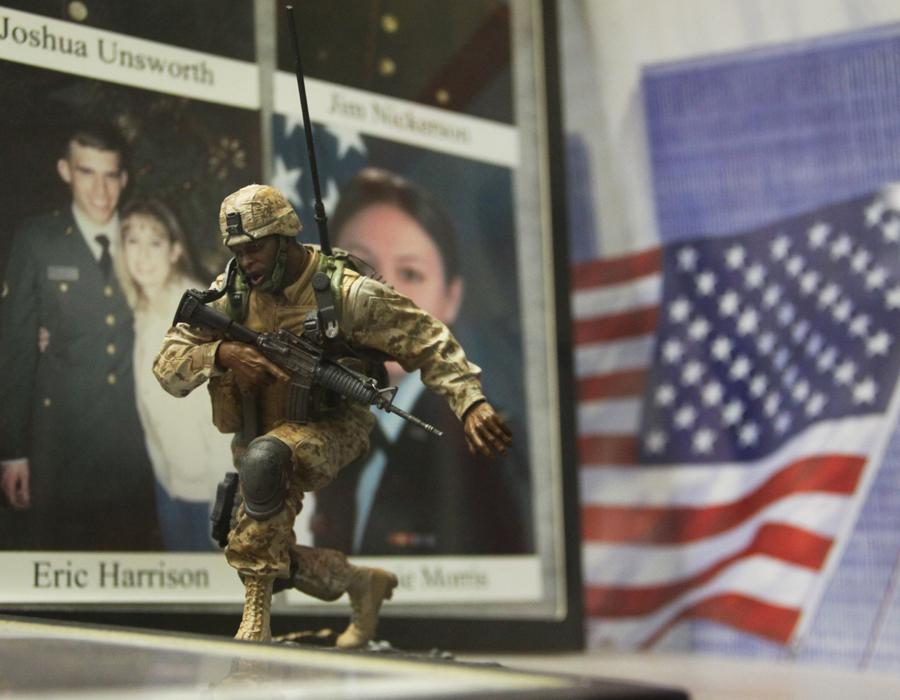 An army figurine sits in the display case outside the library.  The case held many photos of current/past recruiters in the U.S. military that once went to Lake Central, honoring them for their dedication and courage.