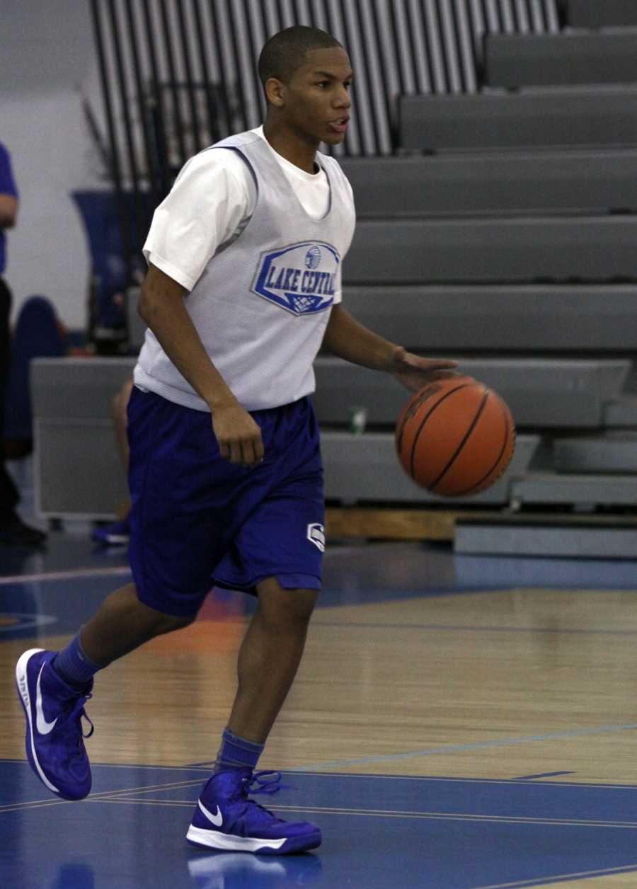 Joseph Bannister (10) dribbles the ball down the court at the scrimmage against Hobart. The boys dominated the court in the second quarter by shutting out the other team.