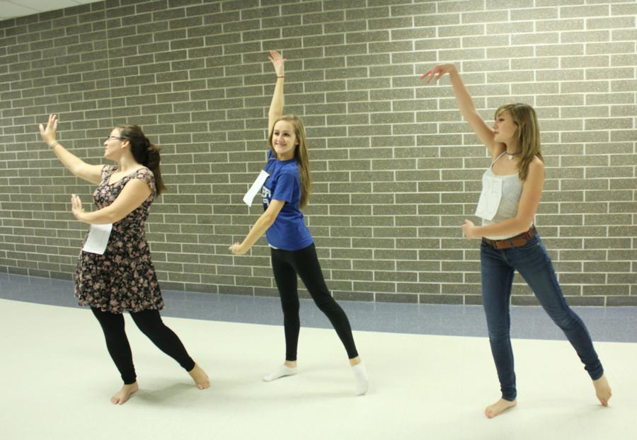 Anastasia Rauch (9), Morgan Horgash (9) and Rachel Yorek (9) practice their dance routine.  Auditions lasted for three hours and involved learning a song and a Caribbean-themed dance.