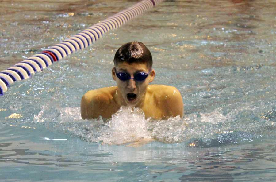 Matthew+Applegate+%2810%29+swims+the+breaststroke+leg+of+the+varsity+200+medley+relay.+He+gave+the+team+a+good+lead+against+Highland.+