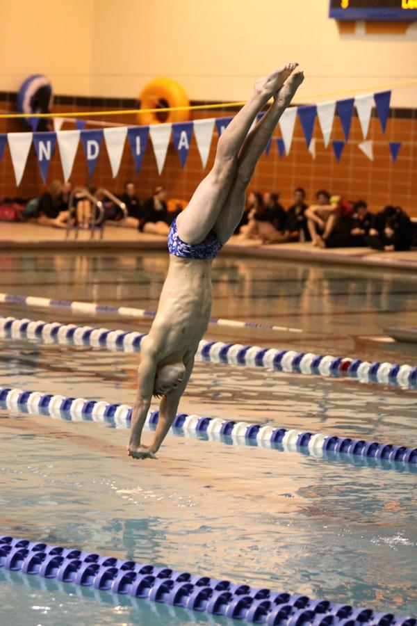 Alexander Morgan (9) dives into the pool at the meet against LaPorte on Dec. 11. Morgan got 3rd in the standings.