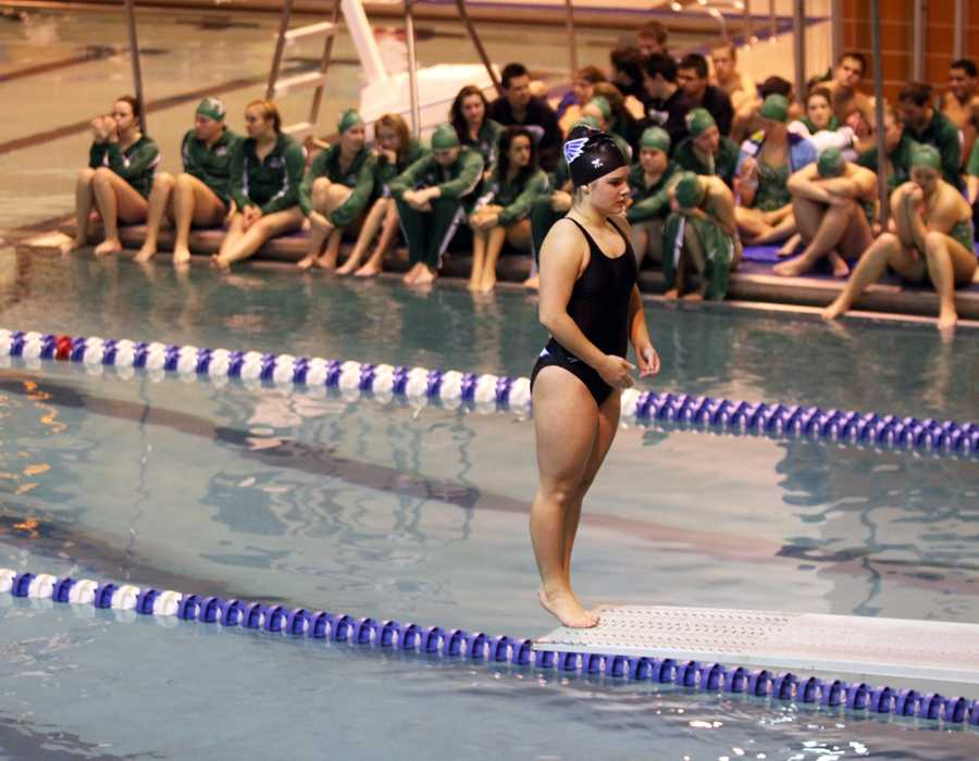 Hannah Leyba (9) prepares to do an inward 1 and ½.  Leyba scored a 7 on this dive and scored first overall in the meet.