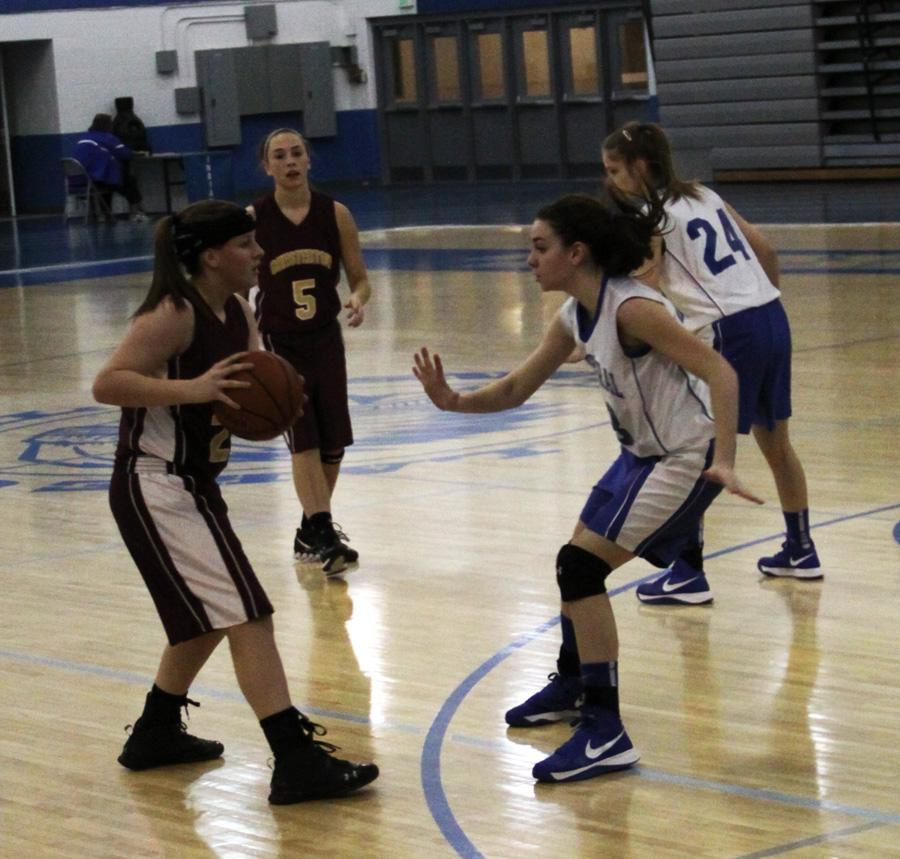 Nicole Verdeyen (9) and Gillian Saternus (9) block two Chesterton players at the Freshman Girls Basketball Conference Championship on Jan. 14. The girls won the conference with a score of 37-34.
