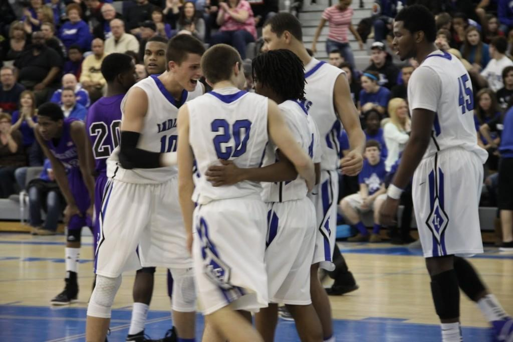 The Indians rejoice after a big basket. They suffered a 57-60 loss at the hands of the Merillville Pirates on Saturday, January 19.