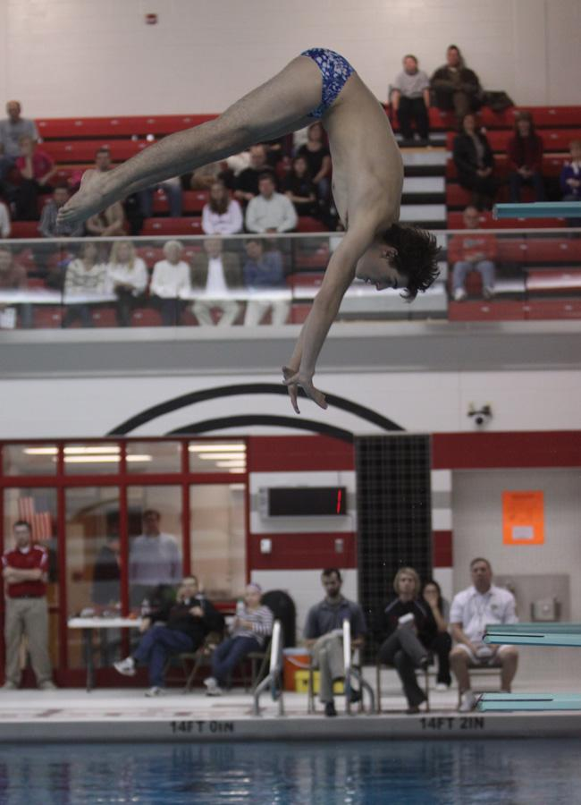 Ryan Bertossi (10) executes an inward dive pike. The dive team dominated their event 13-3 against Munster.
