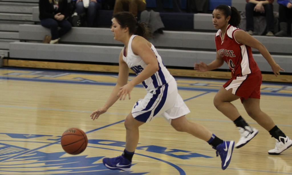 Danielle Morang (10) dribbles past a Portage player. The JV girls basketball team beat Portage 21-11.