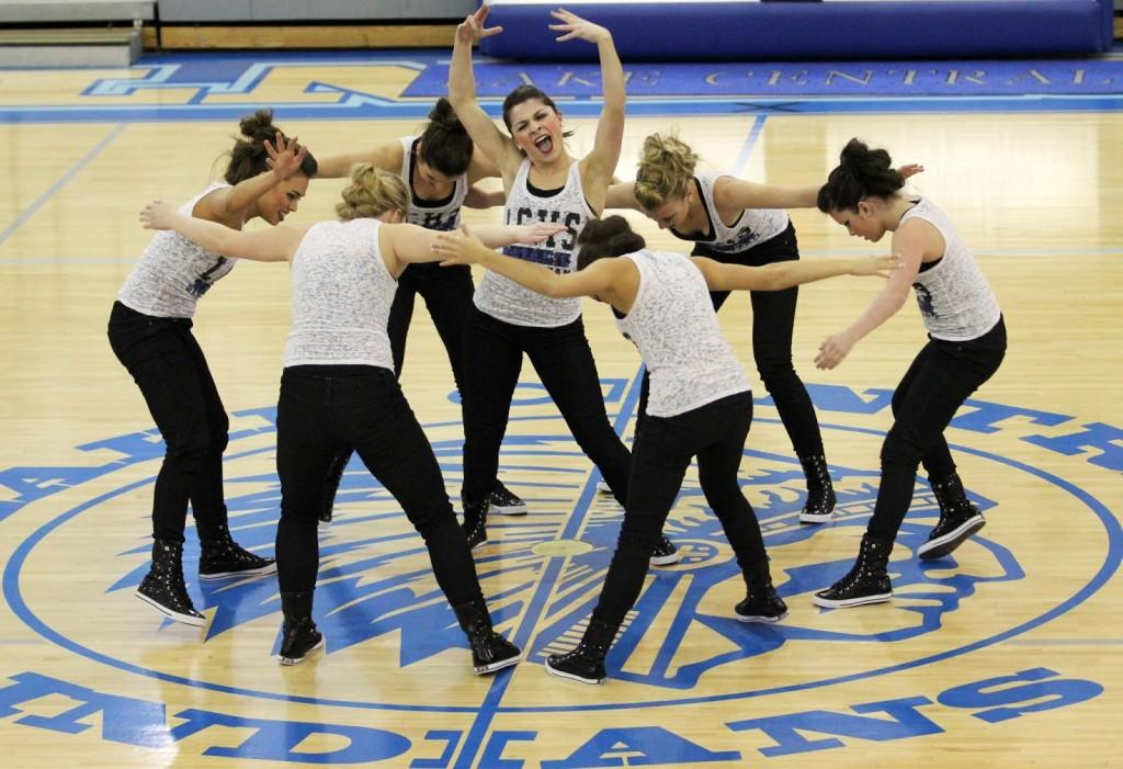Pumped and outgoing, JV Centralettes perform their dance during halftime of the varsity boys basketball game. The girl developed a theme off a mix of hustling music.