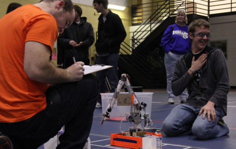 Daniel Shanks (12) takes a sigh of relief after finishing his event 'robot arm.'  Shanks took first in this event at the St. Joseph's Regional.