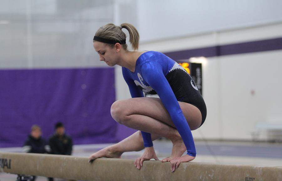 Brittany Vanek (12) prepares to begin her beam routine at the meet against Hobart. The team won the meet and looks forward to the DAC meet.