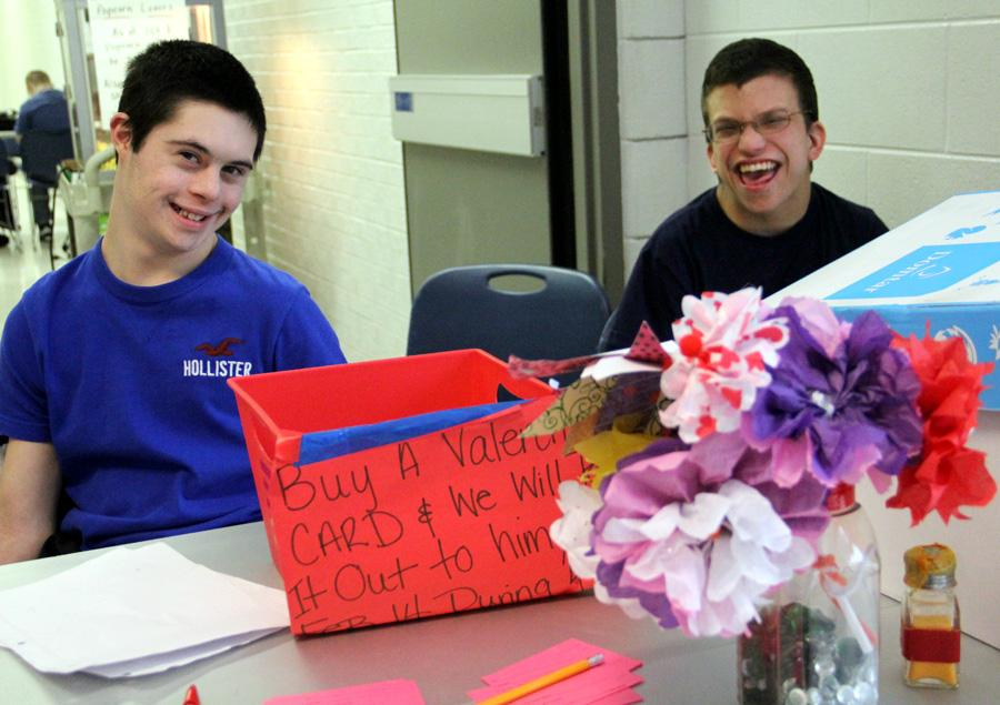 Alec Bisone (11) and Clarence Deckinga (12) watch the booth and take orders from students buying Valentines.  The West Lake students sold Valentines each lunch period and the sale went on for a week and a half.