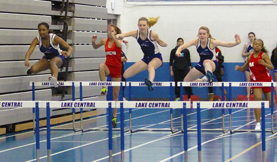 Hurdlers Etura Williams (10), Morgan Olson (9), and Samantha Lane (9) sprint through the 50-meter hurdle race with their Munster competitors on their tails.  The dual meet took place on Saturday, March 9 at 8:30 a.m.