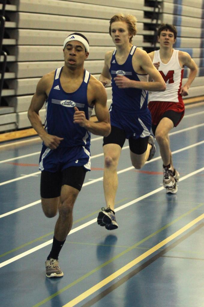 Kelly Kline (12) and Roger Jachna (11) compete in Thursday night's meet against Munster.  Lake Central won the meet.