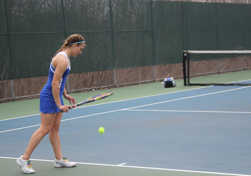 Jory+Swider%2811%29+sets+up+for+a+serve.+The+girls+tennis+team+won+their+recent+match+against+Lowell+5-0+varsity+and+7-0+JV.+