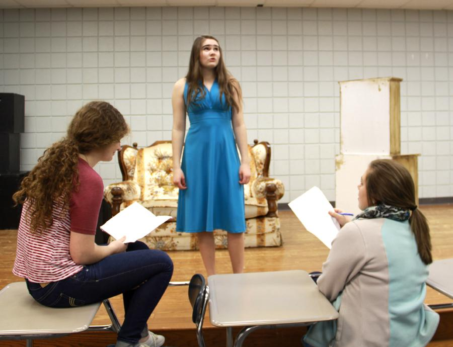 Megan+Barry+%289%29+recites+lines+from+the+short+play+%E2%80%9CHappily+Never+After%E2%80%9D+for+her+upperclassmen+directors+Alyssa+Graziani+%2811%29+and+Lauren+Bourget+%2811%29.++