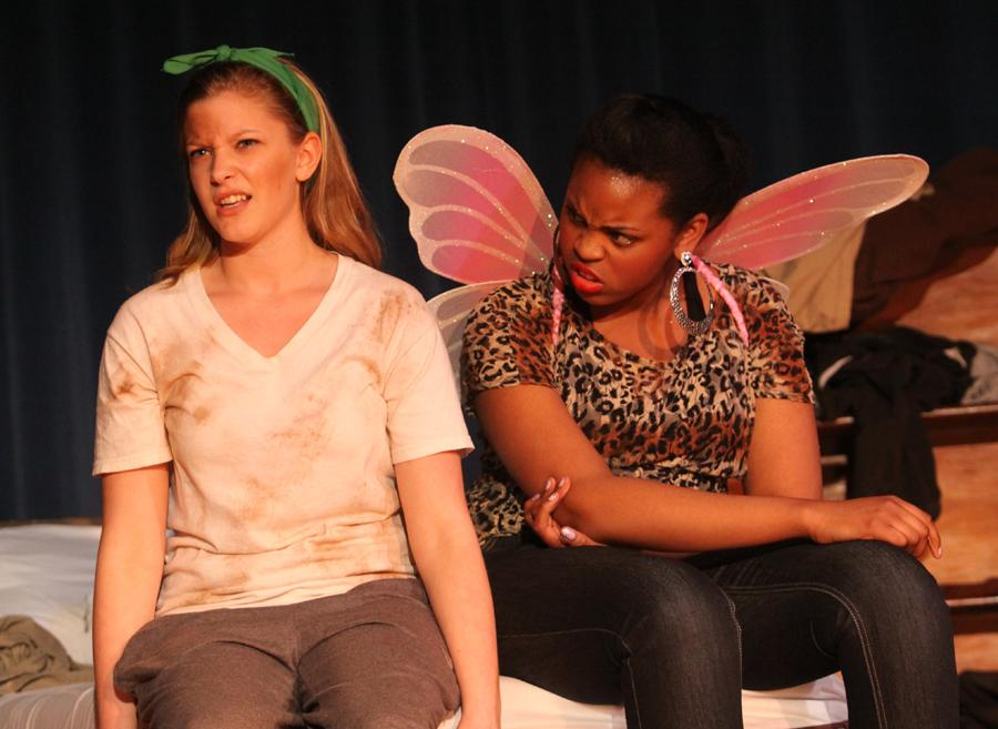 Abigail Keith (9) and Raquel Rembert (9) act out a scene on opening night of the freshmen shows.  Keith acted as Cinderella in the short play and Rembert was her sassy fairy godmother listening to her first real love encounter.