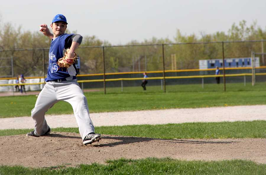 Ryan Ruthrauff prepares to throw the first pitch at the home game against Crown Point. The game took place on Monday May 6, and the boys won the game with a score of 7-4.