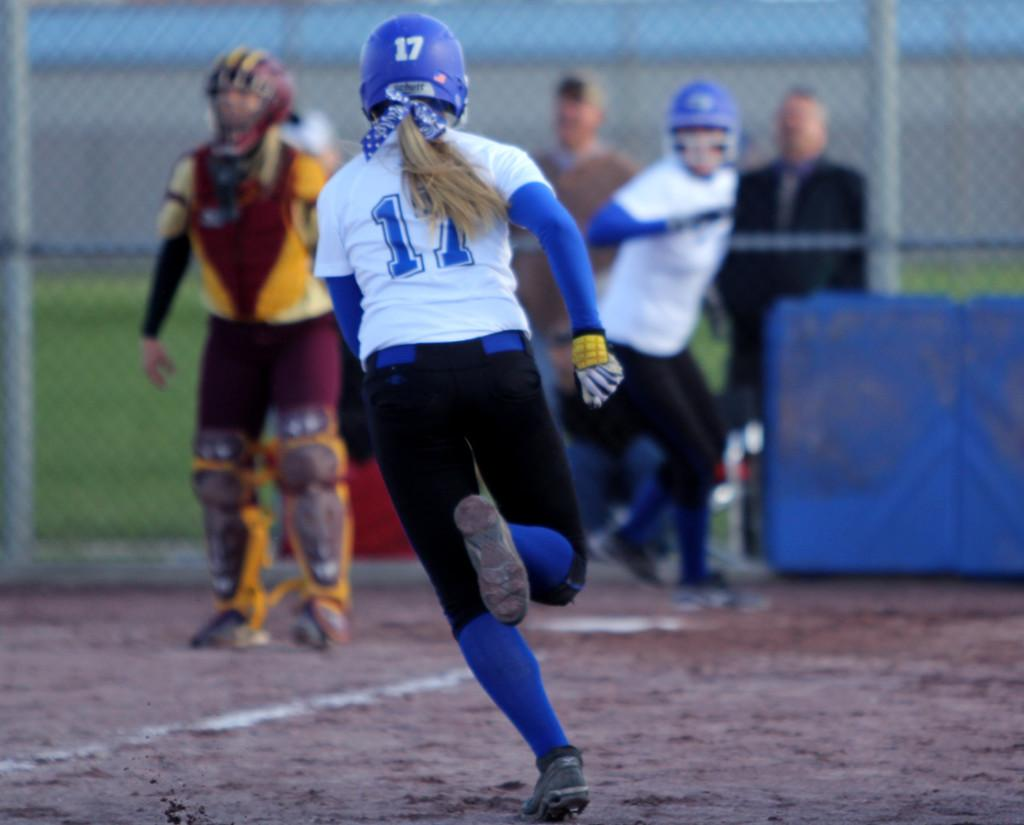 +Kayla+Bishton%2812%29+runs+toward+home+plate+during+the+third++inning.+This+play+pulled+the+girls+ahead+of+Chesterton%2C+making+the+score+4-3.+