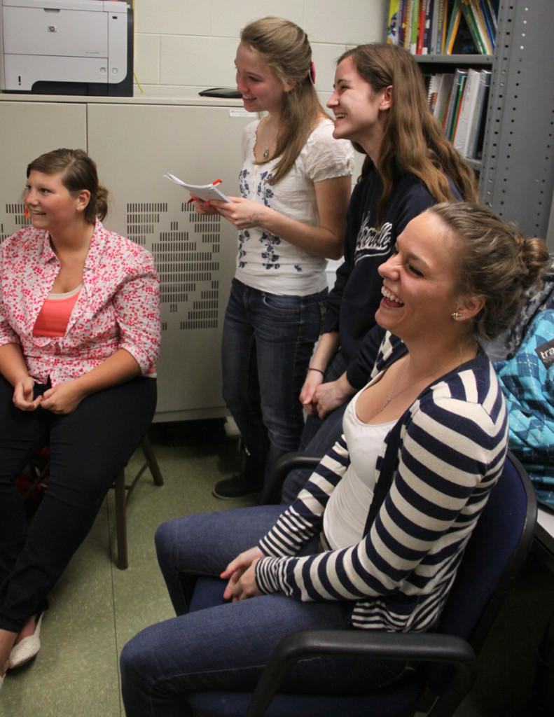 Women In Science and Engineering members, Brandy Gabe (11), Mary Beggs (11), Samantha Browne (11) and Stephanie Pomplin (11) laugh during their meeting. The girls discussed possibilities of science and engineering careers and colleges that would fit these fields.