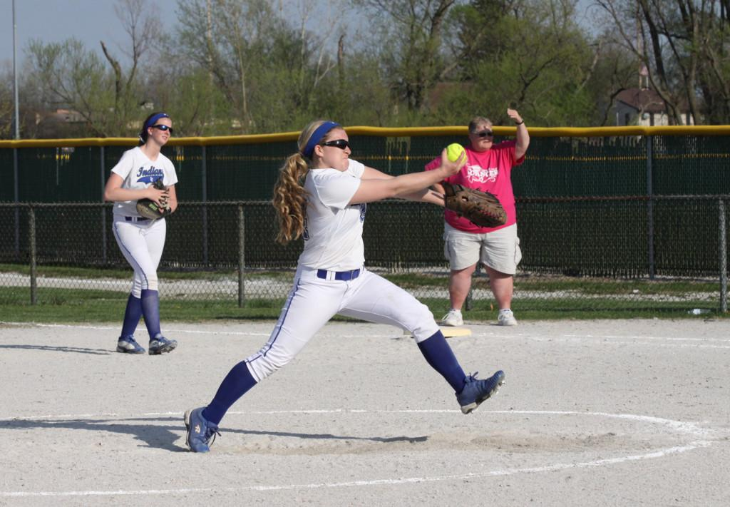Morgan+Ericksen+%289%29+winds+up+to+pitch+to+a+softball+player+from+Michigan+City.+The+team+won+with+a+score+of+13-3.
